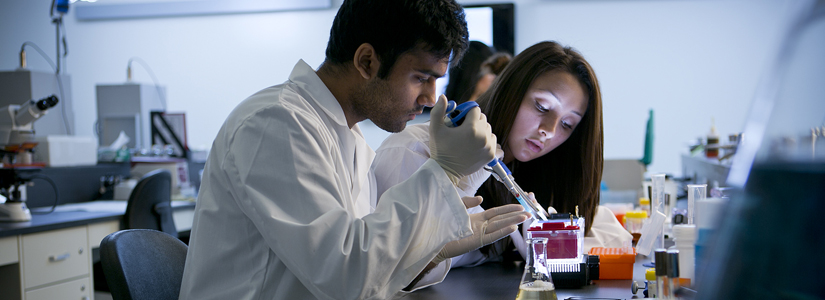 photo of two students working in a lab