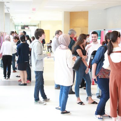 photo of students congregating at students showcase